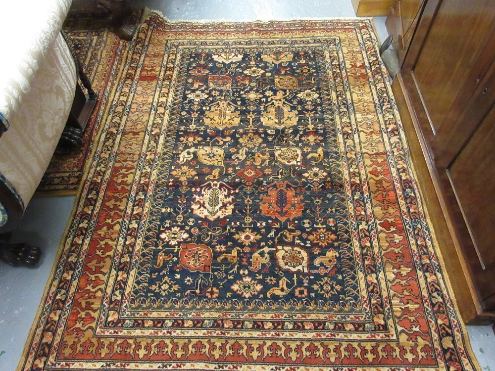 Two machine woven Persian design rugs