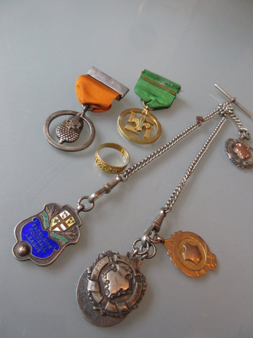 Silver watch chain with various silver fobs and a 9ct