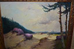 Two framed oils view of a distant town from sand
