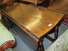 Antique oak oval dropleaf plank top dining table with