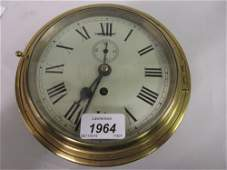 Brass and metal cased ships bulk head clock with Roman