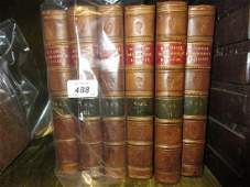 Six volumes half brown leather bound with marble boards