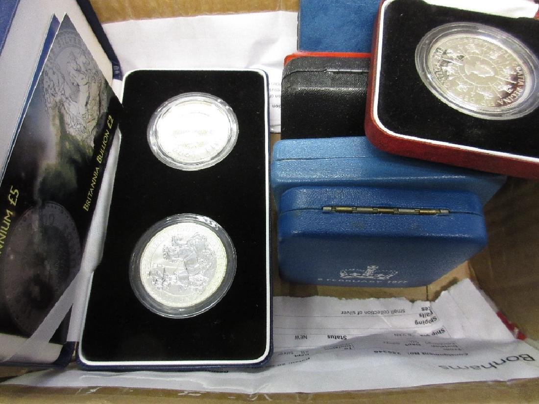 Boxed Millenium silver two coin five and one pound