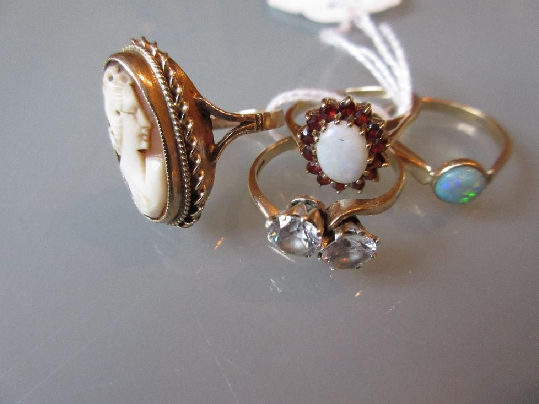 9ct Opal and garnet set flower head ring, another opal