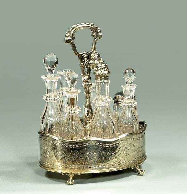 10: Oval English silver plated caster set with six crys