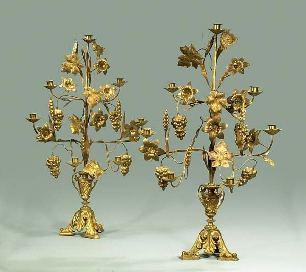 22: Pair of French brass candelabra with flowers and gr