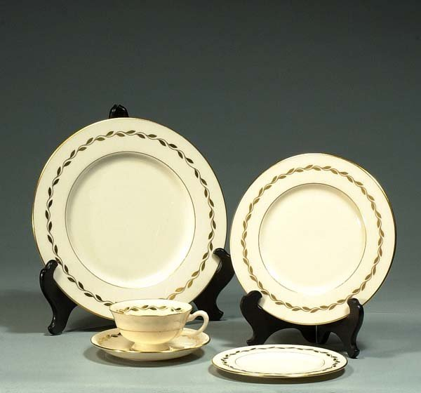 1009: Set of Lenox china with a gold leaf and gold band