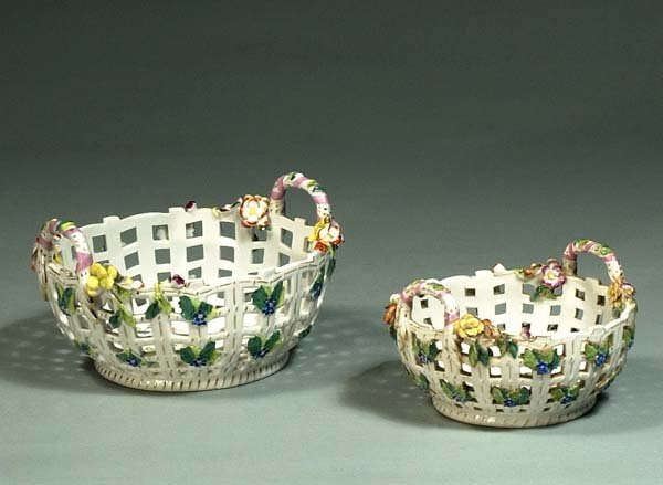 1013: Two Augustus Rex reticulated baskets with floral