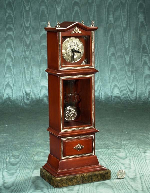 1024: Miniature mahogany grandfather clock with silver