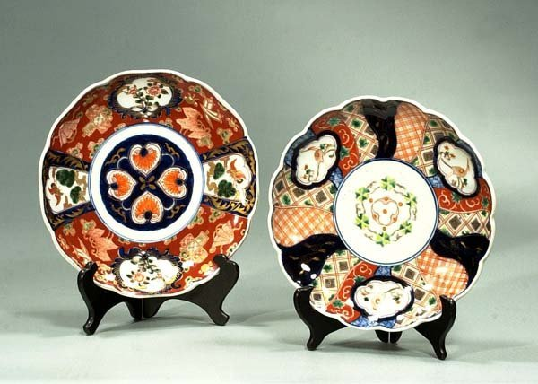 4: Two companion Imari plates with bird and floral deco