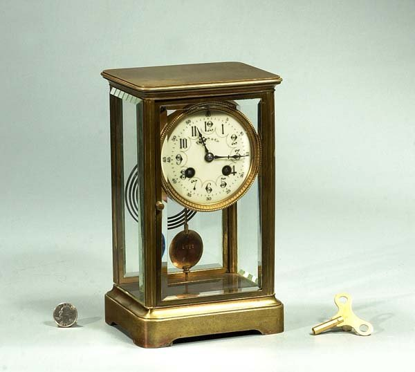 11: French mantle clock in a brass case with beveled gl
