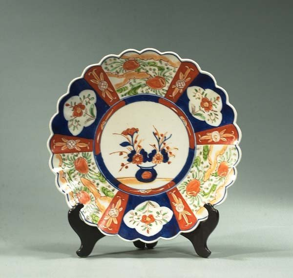 12: Imari porcelain charger with urn and floral decorat