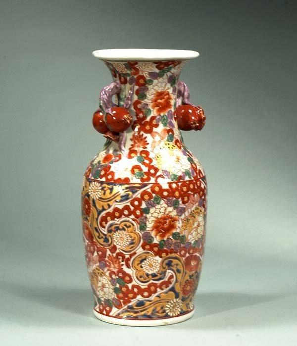 16: Imari porcelain vase with floral and fu lion decora