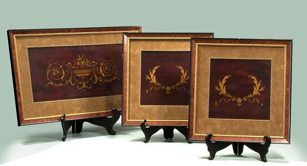 17: Group of three framed wooden panels with satinwood
