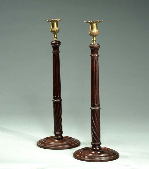 18: Pair of English wooden candlesticks with fluted and