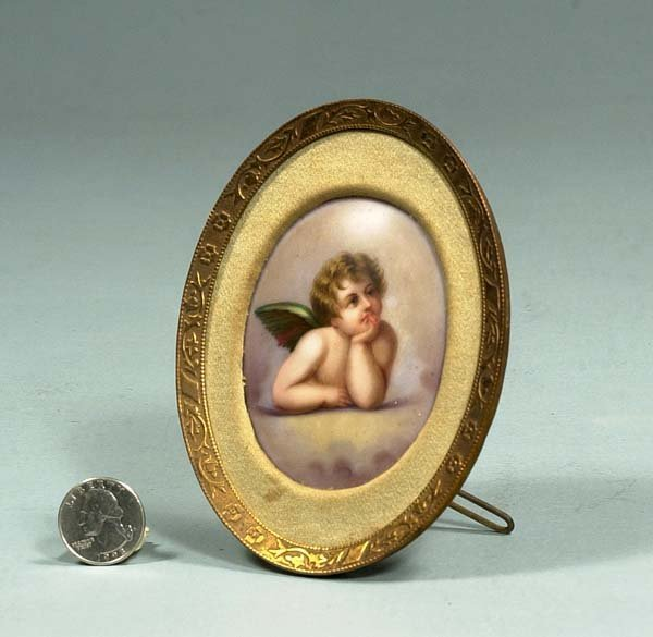 1009: 19th century oval painting on porcelain of a cher