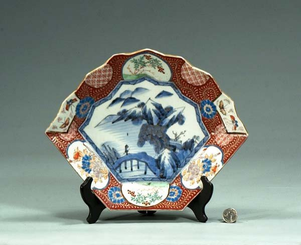 1011: Imari porcelain fan shaped dish with scenic, butt