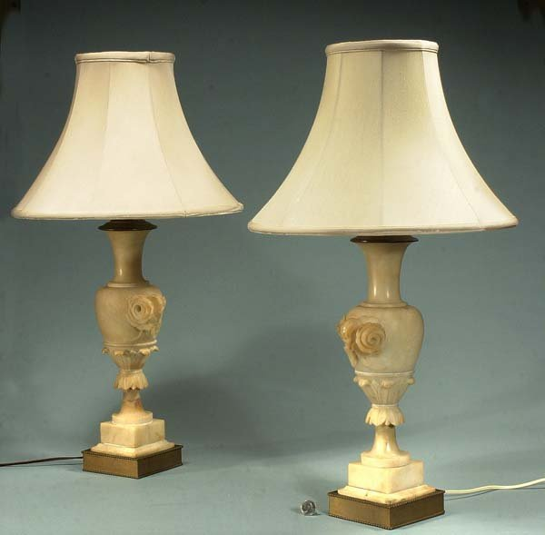 1023: Pair of alabaster urn shaped lamps with rose and