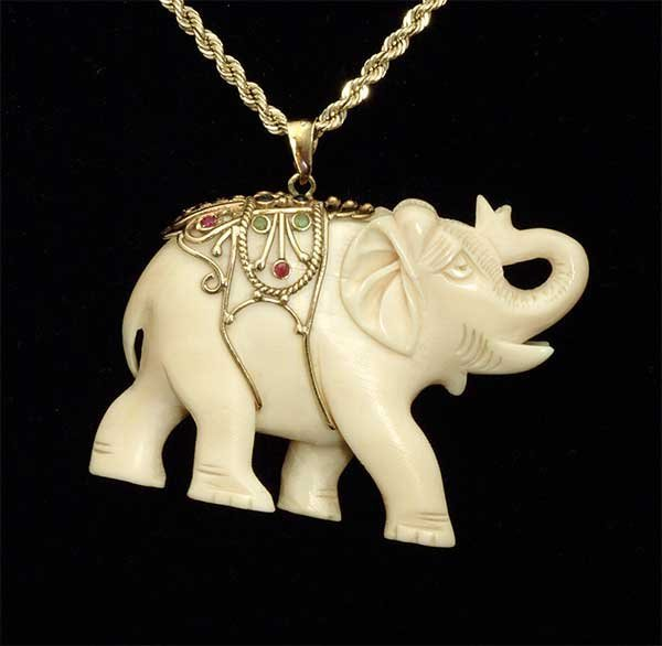 7: Carved ivory elephant pendant with yellow gold mount