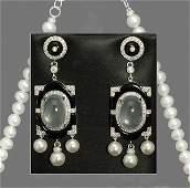 12 Pair of art deco style 18 kt white gold earrings