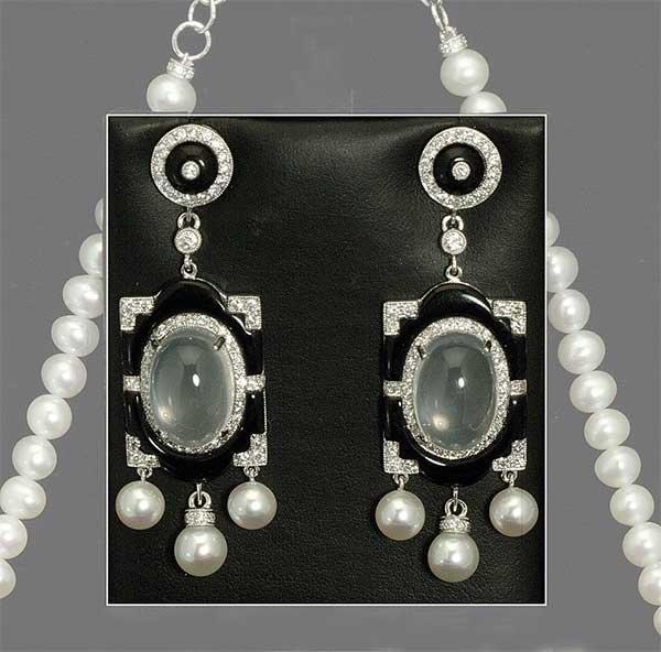 12: Pair of art deco style, 18 kt. white gold earrings