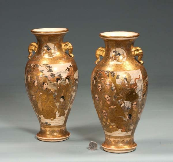 13: Pair of Satsuma vases with gold encrusted scenic an