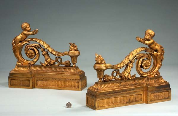 22: Pair of Louis XVI bronze chenet with scroll design