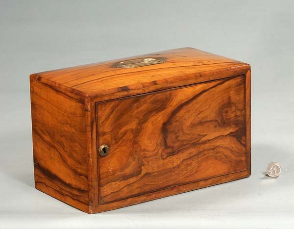 19: English walnut tobacco humidor fitted with a revolv