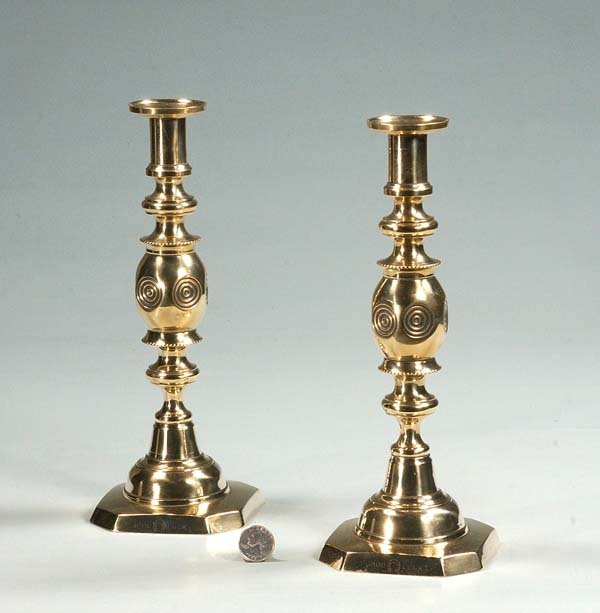 "22:  Pair of English brass ""Bull's Eye"" candlesticks, c"