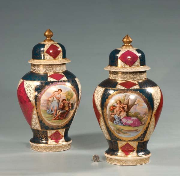 15: Pair of Vienna porcelain dome top urns with scenic