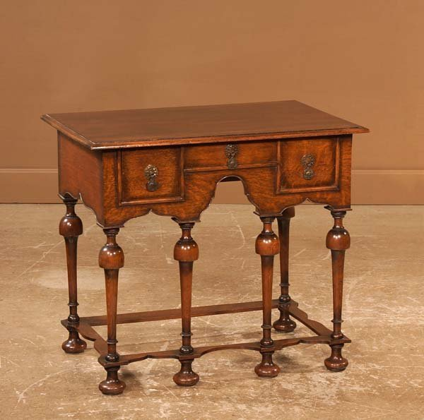 20: William and Mary style oak three drawer lowboy on t