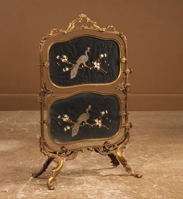 22: Louis XV style bronze two tier stand with crewel wo