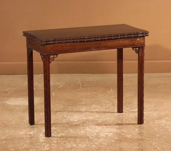 23: Chippendale style mahogany lift top game table on s