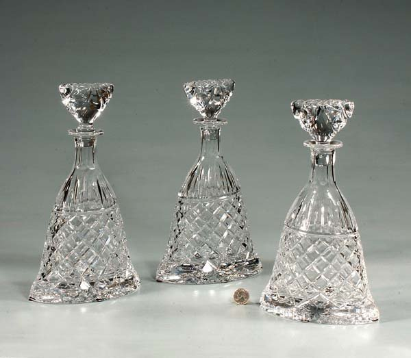 5: Set of three oval cut crystal decanters with cut sto