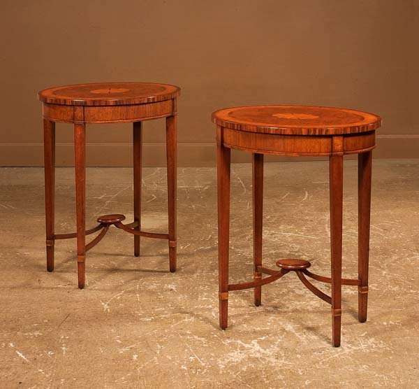 21: Pair of oval Hepplewhite style walnut side tables w