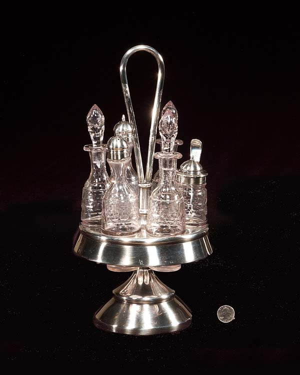2: Six bottle crystal caster set in a silver plated sta