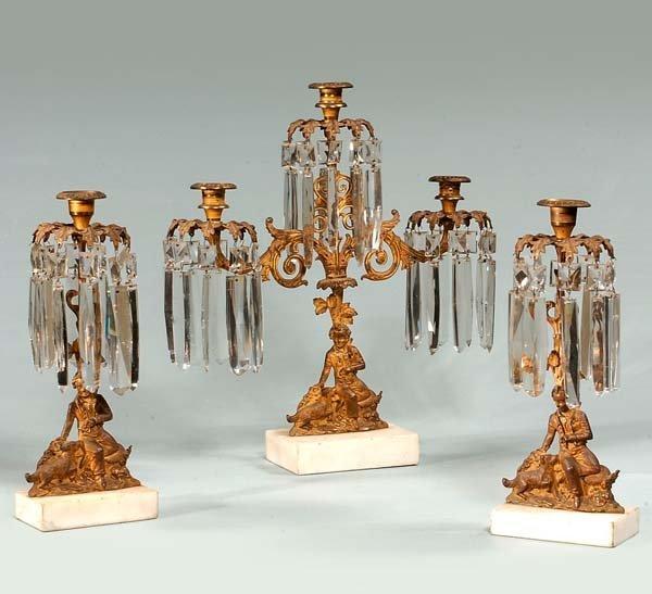 9: Three piece brass girandole with crystal prisms and