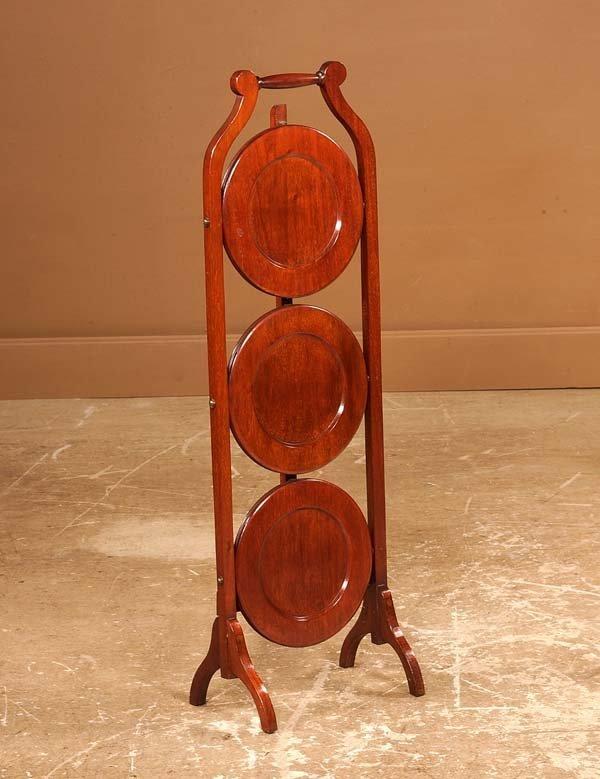 18: Three tier Sheraton style mahogany muffin stand, 11