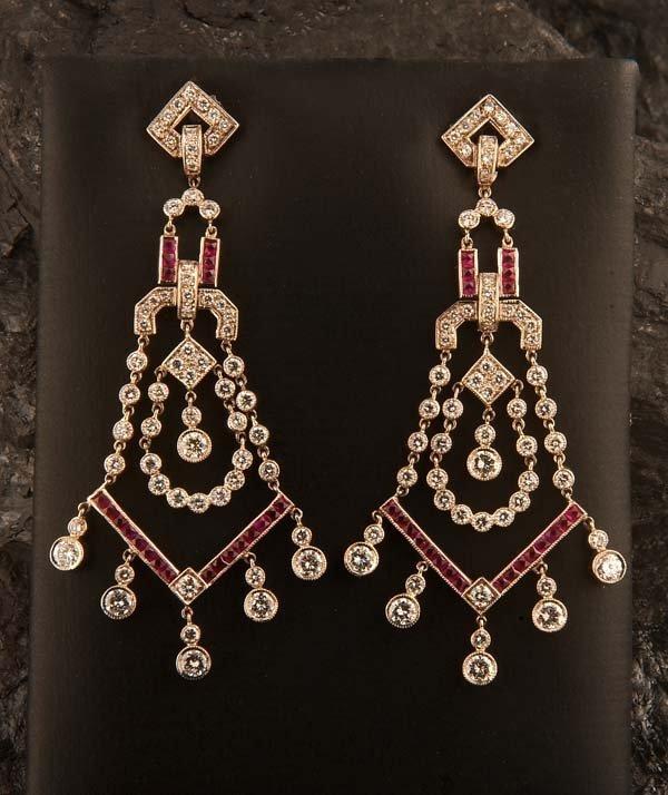 441: Pair of art deco style 18 kt. white gold earrings