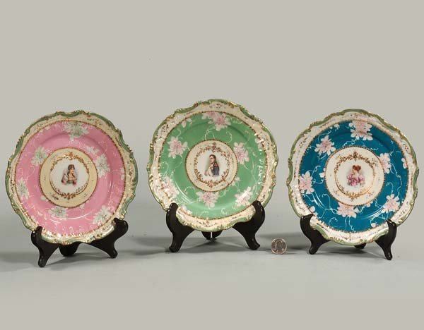 429: Group of three French porcelain plates decorated w