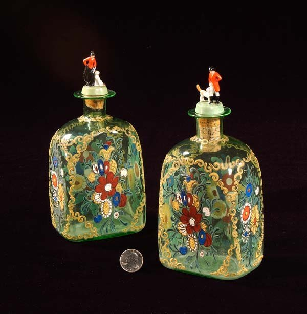 431: Two early blown glass decanters with enamel decora