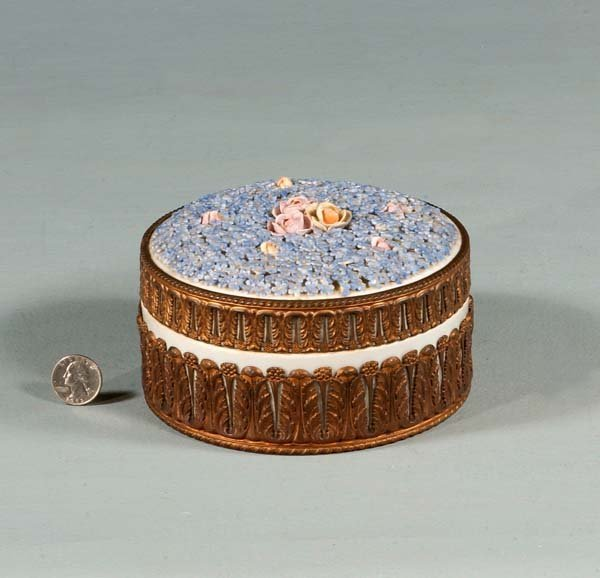 440: Round porcelain box with brass frame and brass tri