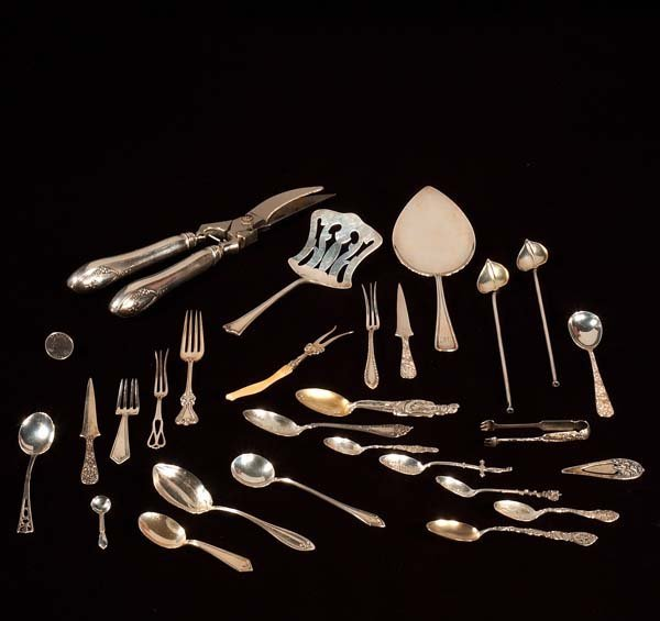 445: A collection of assorted sterling silver flatware,