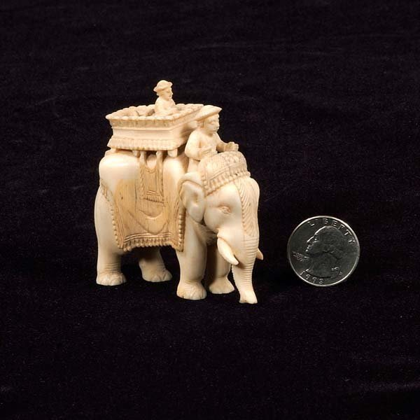 5: Carved ivory elephant with man riding in a basket se