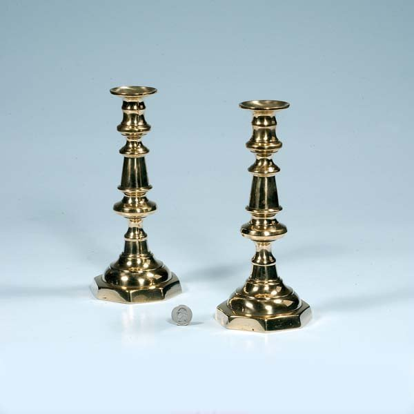 11: Pair of English brass bell shaped candlesticks, c.1