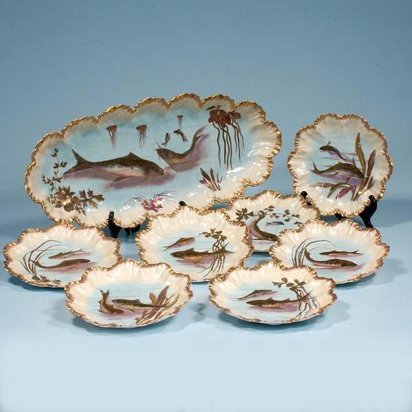 16: French china fish platter and nine plates, c.1890;
