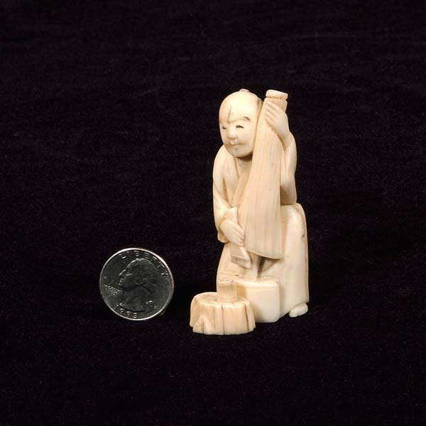 17: Carved ivory figure of a man holding an umbrella, 3