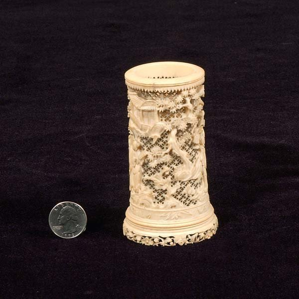 18: Carved ivory cylinder vase with intricate figural a