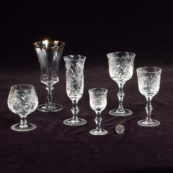 21: Set of cut crystal stemware, 12 goblets, 12 brandie