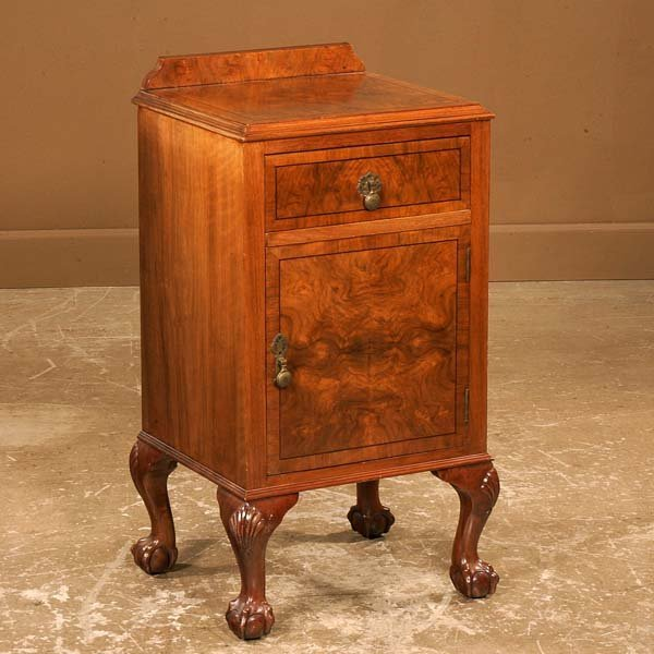 23: Chippendale walnut bed side cabinet with one drawer